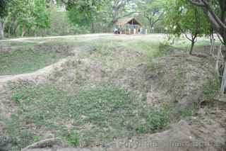 Choeung Ek Genocidal Center, killing fields excavated pit, Cambodia