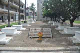 Tuol Sleng Genocide Museum courtyard tombs
